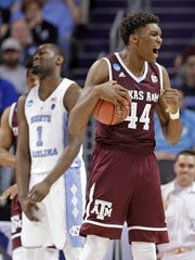 Texas A&M's Robert Williams (44) celebrates in the first half against North Carolina in Charlotte, N.C., Sunday, March 18, 2018.