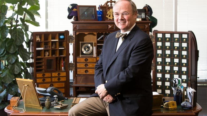 Finance industry veteran, Chris Volk is the CEO of STORE Capital, a real estate investment trust. He poses in his Scottsdale office on Tuesday, Aug. 26, 2014.