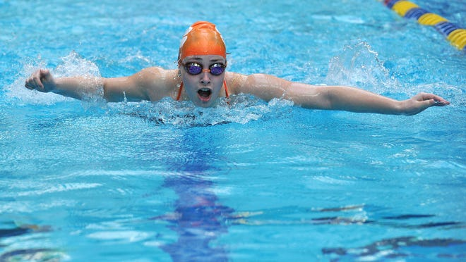 Mansfield Senior's Grace Haring swims the 100 butterfly in Saturday's Ohio Cardinal Conference meet. Haring placed third in the race.