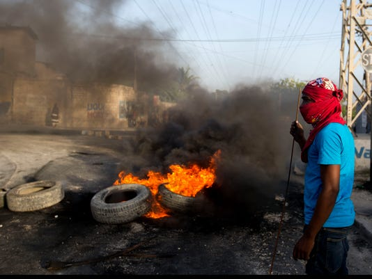 AP APTOPIX HAITI FUEL PROTESTS I HTI