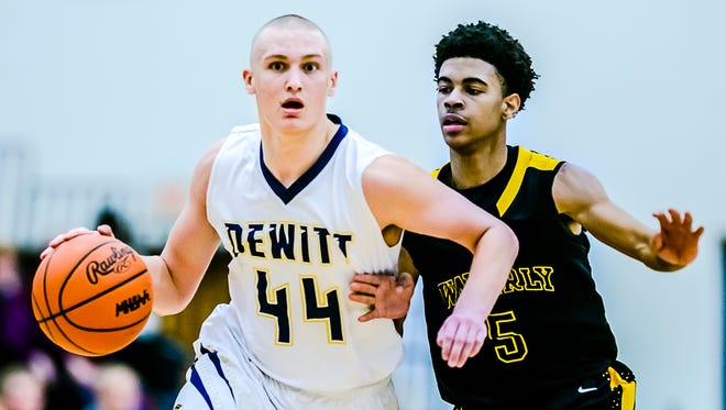 Tanner Reha ,44, of DeWitt drives to the basket while being defended by Lavell Fomby of Waverly during their game Friday February 12, 2016 in DeWitt.  KEVIN W. FOWLER PHOTO