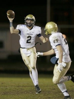 Chelsea quarterback Jack Bush completes a short pass to Trey Seitz for a first down in the second half to their 35-12 win over Allen Park in high school football on Friday, November 13, 2015, in Allen Park. Julian H. Gonzalez/Detroit Free Press