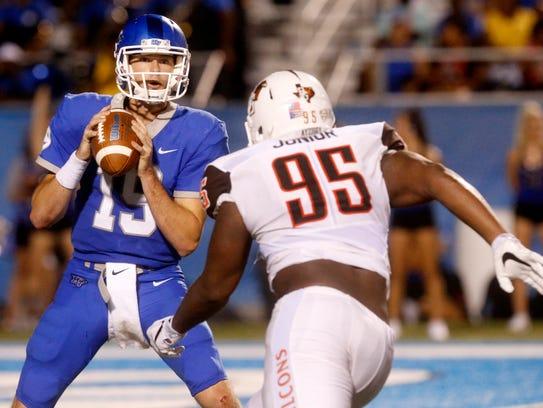 MTSU's quarterback John Urzua (19) looks for a receiver