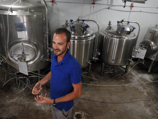Daniel Anderson, co-owner of Sidecar Brewing, describes