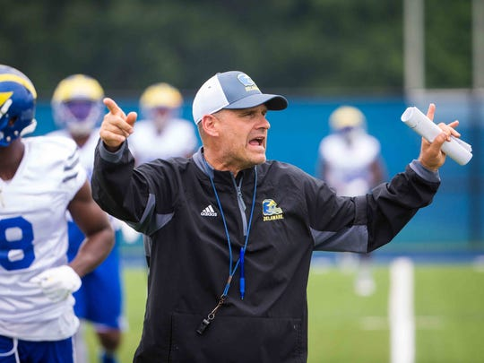 New University of Delaware football coach, Danny Rocco, calls out the new drills during Friday's practice.