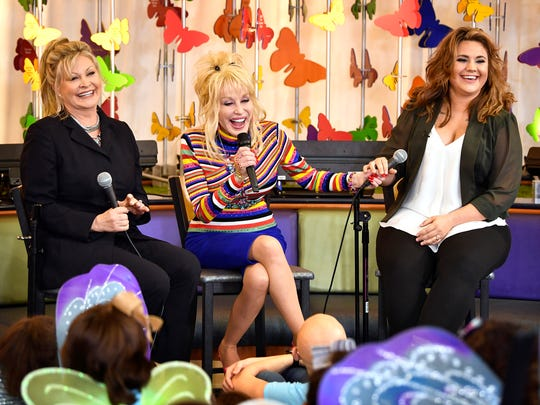 "Dolly Parton met with cancer patients at Monroe Carell Jr. Children's Hospital at Vanderbilt on Oct. 13, 2017, to sing songs from her new children's album and share a story of how niece Hannah Dennison, right, recovered from cancer at the hospital and inspired her new song ""Chemo Hero."" Dolly's sister Rachel Dennison is at left."