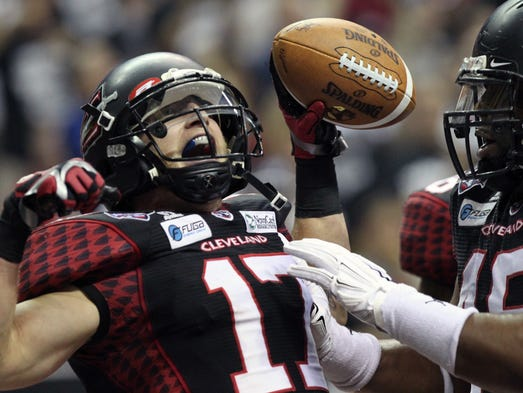 Cleveland Gladiators wide receiver Collin Taylor celebrates the team's first touchdown in the first half against the Arizona Rattlers in the ArenaBowl on Aug. 23, 2014.