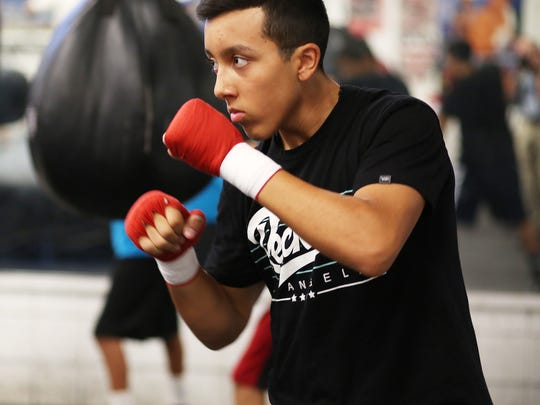 Joel Diaz Jr is photographed working out at the Indio Boys and Girls Club boxing facility in Indio CA,, Thursday, July 10, 2014. He will be on the fight card for the Desert Showdown boxing event at Fantasy Springs Resort Casino next week.