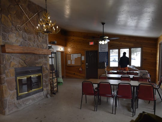 Inside the Winter Park chalet warming area and its roaring wood fire.