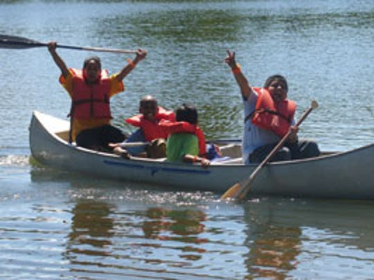Campers canoe at Camp Paradise Valley.