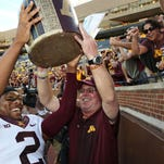 Jerry Kill, right, the Big Ten Coach of the Year in 2014, could have his best team yet at Minnesota. A daunting schedule that includes possibly the nation's No. 1 (Ohio State) and No. 2 (TCU) preseason national teams will test the Gophers.