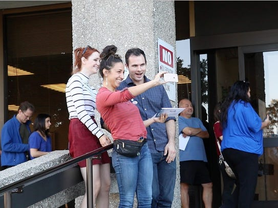 Voters take a group selfie outside a polling facility