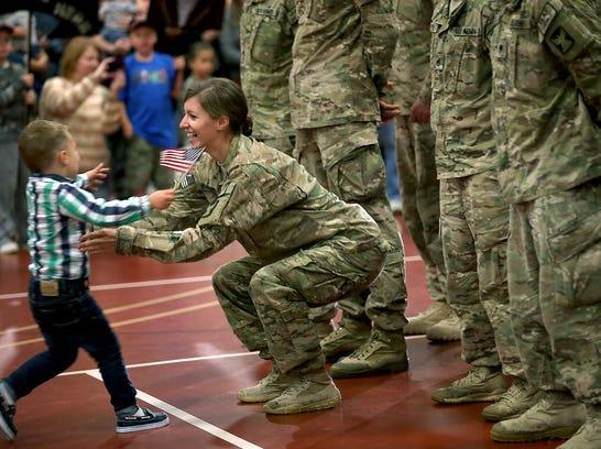 AP_APTOPIX_Soldiers_Return