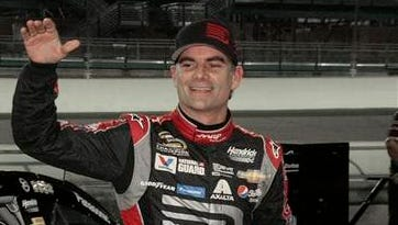 In this Nov. 14, 2014, file photo, Jeff Gordon celebrates after qualifying laps for the EcoBoost 400 auto race in Homestead, Fla. Gordon says he will retire as a full-time driver after the 2015 season.
