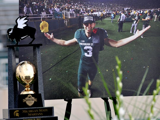 A giant photo of Mike Sadler is on display at his memorial at Spartan Stadium Sunday, July 31, 2016. The star punter was killed in a car crash July 23rd.