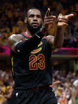 Cleveland Cavaliers' LeBron James reacts after a play against the Boston Celtics in the first half of Game 4 on Monday.