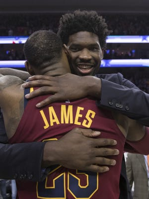 LeBron James hugs Joel Embiid after a game at the Wells Fargo Center on April 6, 2018.