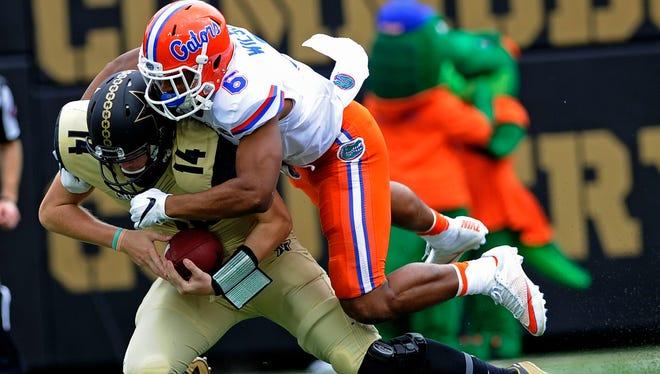 Vanderbilt quarterback Kyle Shurmur (14) is tackled Florida defensive back Quincy Wilson (6) at Dudley Field Saturday, Oct. 1, 2016, in Nashville, Tenn.