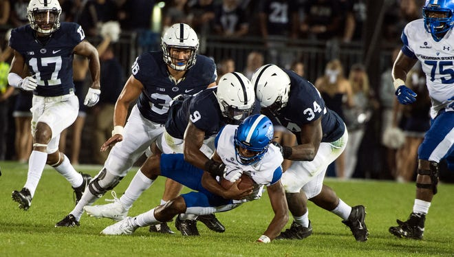 Penn State's linebackers and defensive line will be on the spot Saturday night in Iowa City. Jarvis Miller (9) and Shane Simmons (34) must contain the Hawkeye running game and shake up first-year QB Nate Stanley.