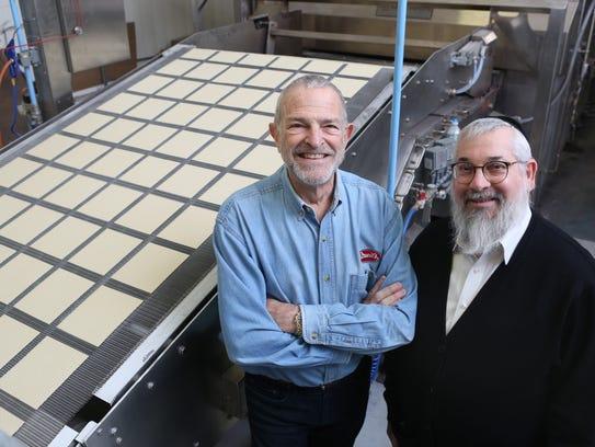 Co-owner Alan Adler and Rabbi Mayer Kirshner beside