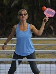 Lynn Crane sets up to bat down a lob.
