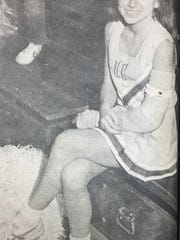 Missie Lopez was sidelined with a broken arm after falling from a pyramid during cheerleading practice in March 1984. The injury didn't prevent her from supporting the Braves, though.
