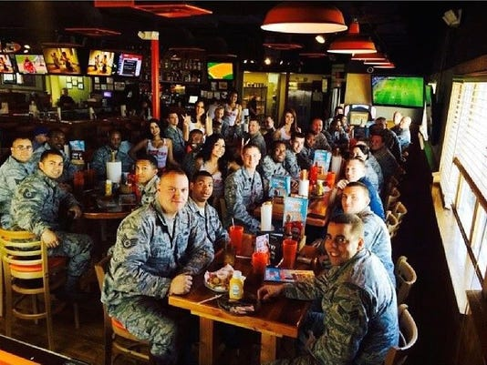 XXX MILITARY GROUP AT HOOTERS.JPG A FILE