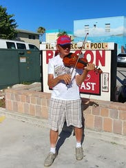 Robbie Michalec, of Fort Myers, plays the violin as