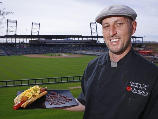 Chef Travis Potts with a Mega Dog at Salt River Fields.