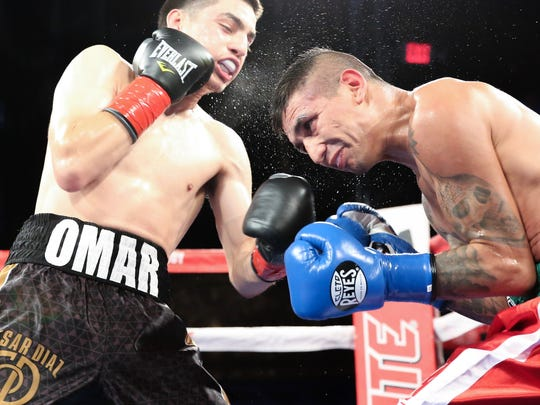 Cesar Diaz, left, was 7-0 as a professional boxer, with six knockouts.
