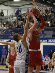 Canton's Chase Meredith goes up for the shot as CC's Mike Harding goes up for the block.