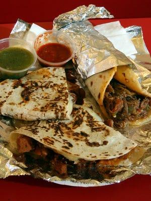 Patrons line up to order food at Burritos Crisostomo, 5658 N. Mesa. Asado pork and shredded beef burritos on freshly made tortillas.