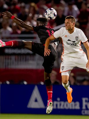 Phoenix Rising FC forward Jason Johnson and Orange County SC defender Thomas Juel-Nielsen jump for the ball on June 29, 2018, during Phoenix Rising F.C's matchup against the Orange County Soccer Club at the Phoenix Rising FC Soccer Complex in Tempe, Arizona.