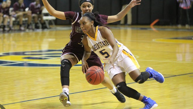 Angelo State University's Kynese Davis (5) drives around West Texas A&M's Megan Gamble during a Lone Star Conference women's basketball game at the Junell Center on Thursday, Jan. 11, 2018. The Rambelles handed the No. 2-ranked Lady Buffs a 68-51 loss, their first of the season.