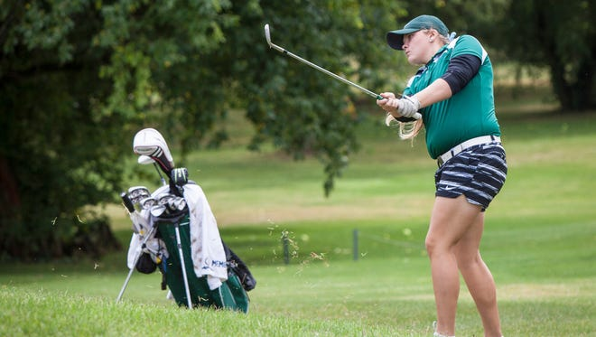 Reece Malapit with Yorktown takes a chip shot on Saturday during the girls golf sectional at Crestview Golf Club.