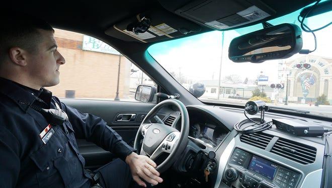 Officer Scott Davis of the Bucyrus Police Department patrols North Sandusky Avenue on Wednesday afternoon.