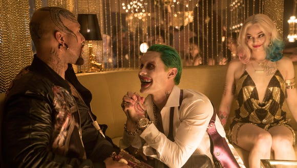 Jared Leto as Joker (center, with Common) and Margot