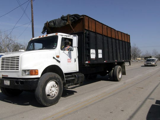 An AshBritt subcontractor hauls away Katrina induced