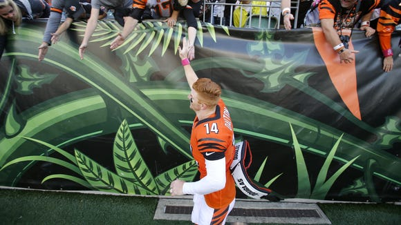 Cincinnati Bengals quarterback Andy Dalton (14) gives