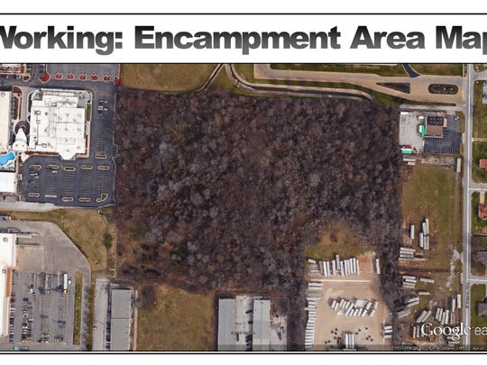 This is an aerial image of the wooded area behind Walmart near Kearney and Glenstone. Homeless people had camped there for about 30 years. The city wants to clear the property except for trees over six feet.