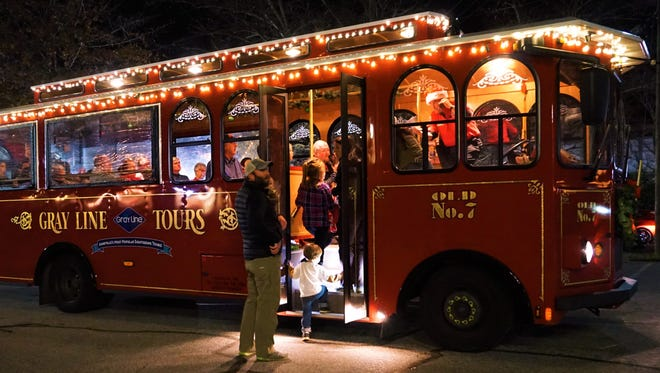 Gray Line Trolley Tours get dressed up for Christmas with lights, and the programming includes songs and stories.