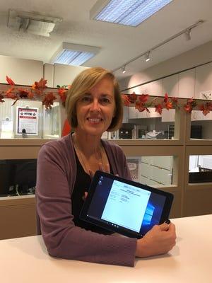 Farmington deputy clerk Mary Mullins with the tablet.