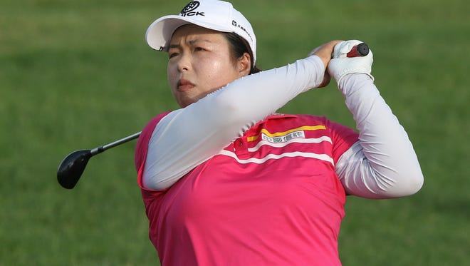 Shanshan Feng hitting off the 18th fairway at the U.S. Women's Open on Saturday, July 15, 2017.
