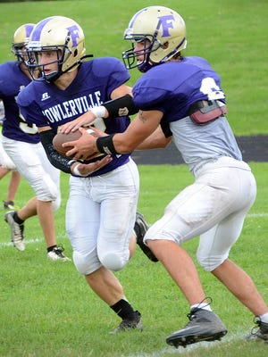 Fowlerville quarterback Nick Semke (right) has thrown two passing touchdowns to Josh Nabozny (left) and has rushed for four more in the Gladiators' 2-0 start.