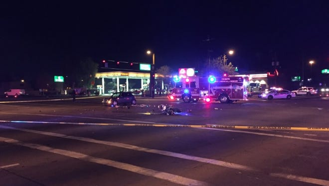 One person died after a three vehicle collision involving a motorcycle occurred at Broadway Road and 48th Street Saturday night, officials said.