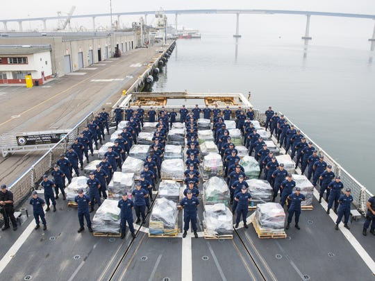 The crew of the Coast Guard Cutter Waesche offloads approximately 18 tons of cocaine in San Diego on June 15, 2017.