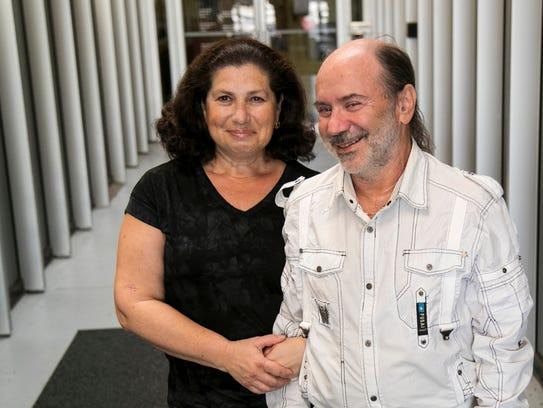 Alex and Marina Goldstein work in their office in Naples