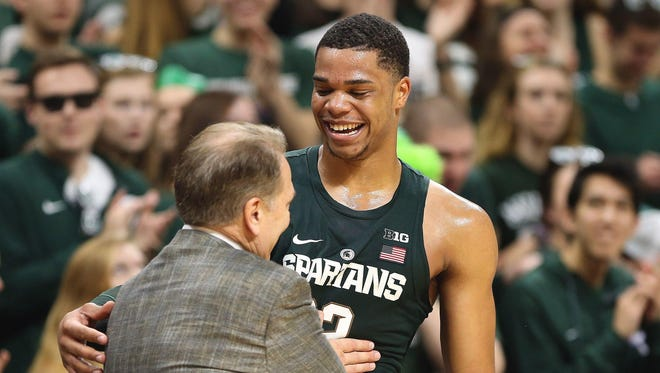 Michigan State coach Tom Izzo jokes with Miles Bridges during the second half of MSU's 88-72 win Thursday, Feb. 23, 2017 over Nebraska at Breslin Center.
