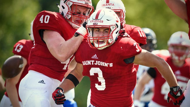 Dusty Krueger of St. John's University celebrates following a play in the first quarter Saturday, Sept. 2, during the game against St. Scholastica at Clemens Stadium in Collegeville.