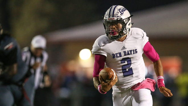 Ben Davis Giants quarterback Reese Taylor (2) moves the ball toward the end zone during second quarter game action at Lawrence Central High School, Indianapolis, Friday, Oct. 6, 2017.